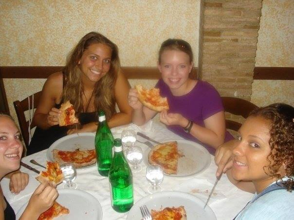 Four girls eating pizza in Italy