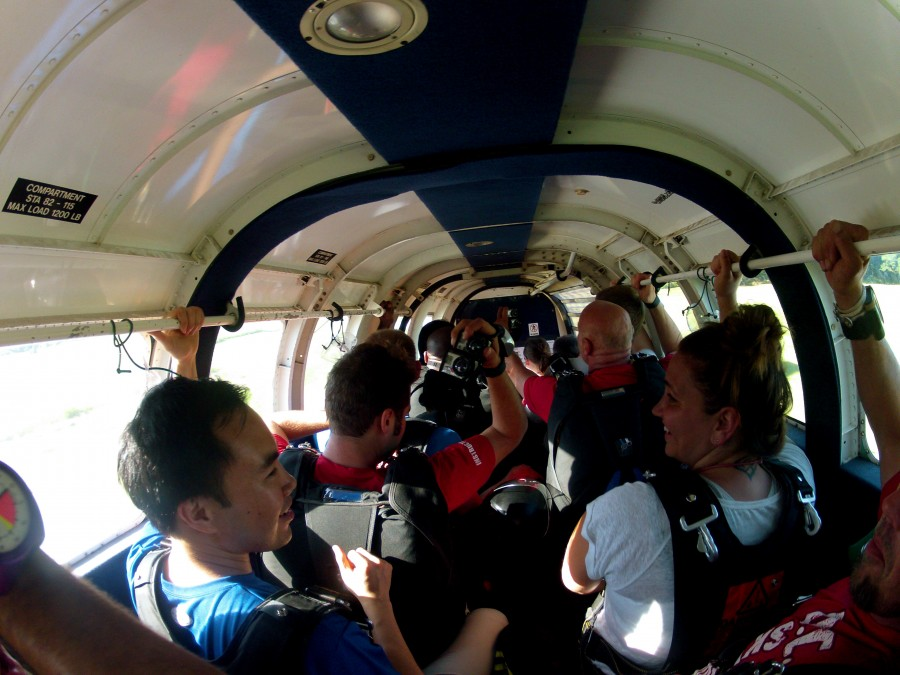People sitting in a plane ready to skydive