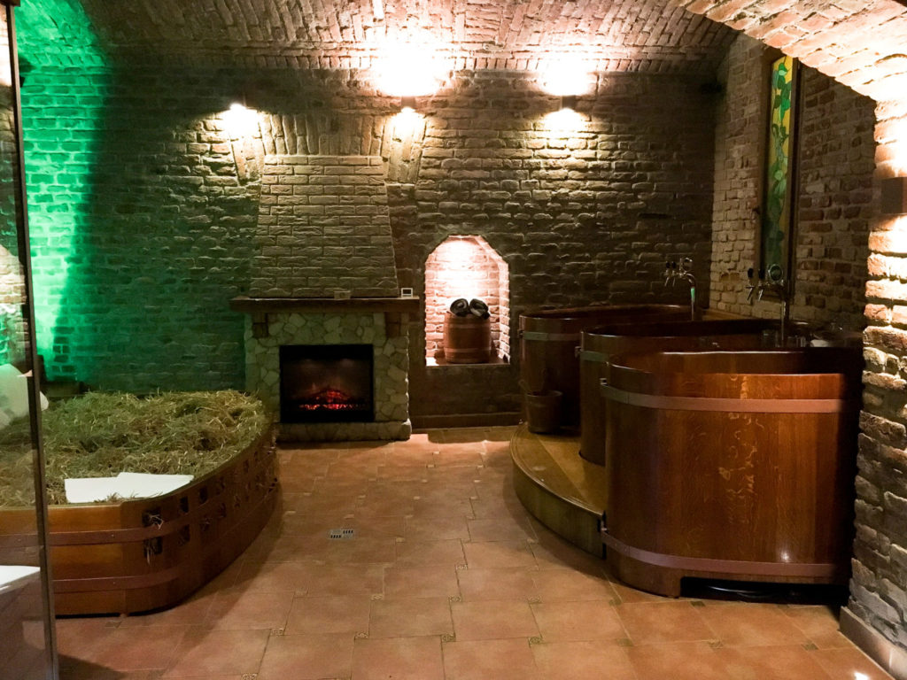 The beer spa room with hay bed and fireplace