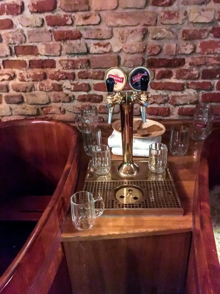 Beer taps next to the beer bath