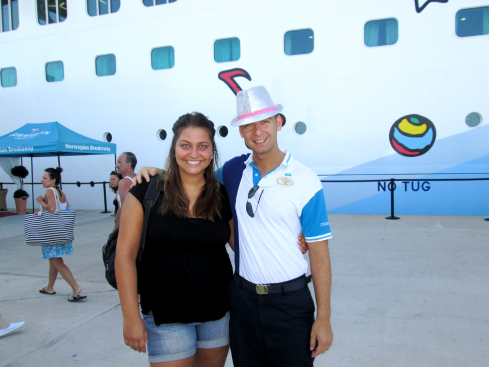 Girl with a member of the staff on a Norwegian cruise ship