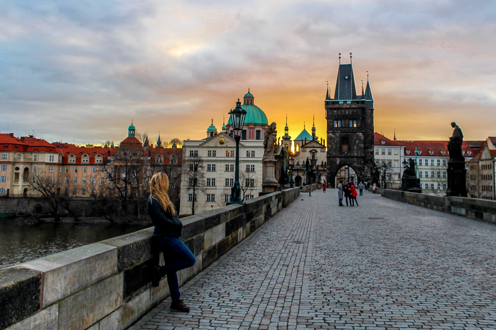 Girl during sunrise on Charles Bridge