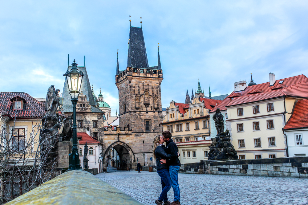 Couple kissing on Charles Bridge