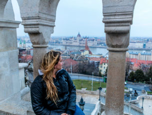 Girl looking out onto the city of Budapest
