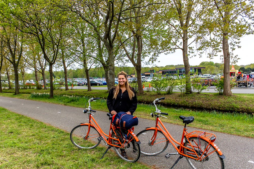 Girl with two bikes in Amsterdam