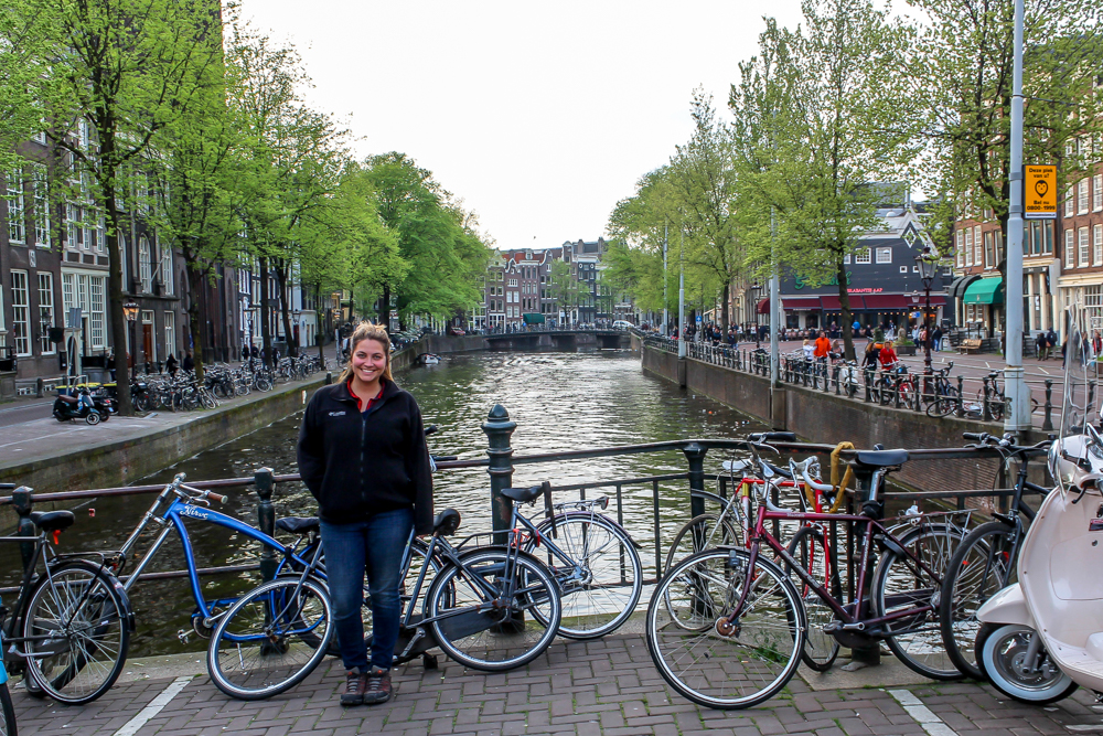 Girl in front of canal in Amsterdam