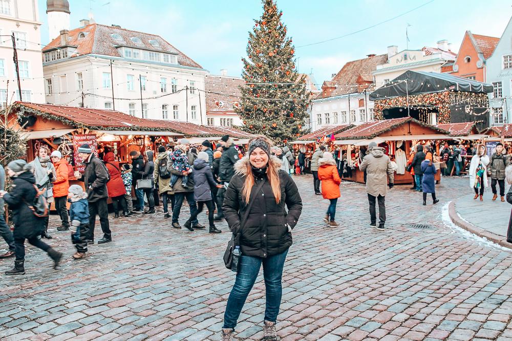 Girl in front of Tallinn Christmas market