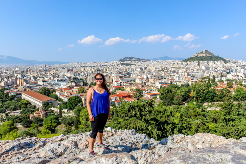Girl standing with an overview of Athens