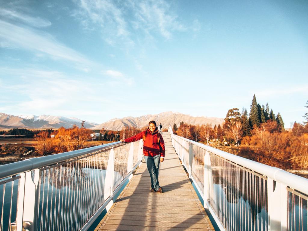 Girl on a bridge at Lake Tekapo