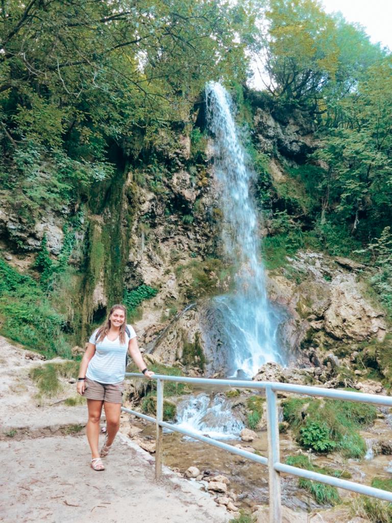 girl by a waterfall in serbia