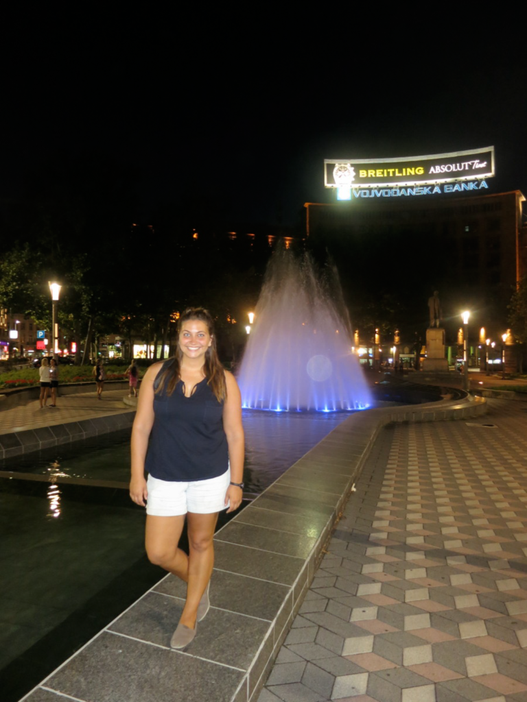 Girl by a fountain
